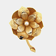 Gold tone floral brooch with cultured pearl center and red glass stone