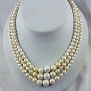 Fantastic coloring in this iridescent white glass faceted bead triple strand necklace