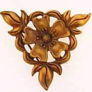 Floral gold tone brooch signed PP