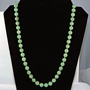 Shiny olive green quartz beaded necklace with slide in barrel like closure silver tone