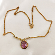 Delicate faceted Amethyst colored glass pendant necklace gold tone