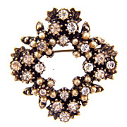 Delicate smaller brooch with imitation pearl flowers and bright rhinestones