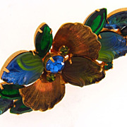 Gorgeous gold tone floral brooch with molded glass leaves and flowers