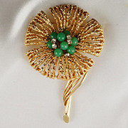 Floral brooch flower & stem design with green glass beads & crystal in gold tone