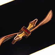 Lovely gold filled early 1900's bar pin with channel set red glass stones