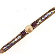 Thin Edwardian silver tone bar pin with imitation pearl cabochon and purple stones