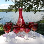 Cranberry Colored Glass Decanter and Six Glasses Decorated with Flowers