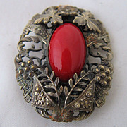 Ca 1930 Czech Red Glass in Brass Foliage Dress Clip