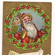 Santa Holds an Address Book with Toys Postcard 1910