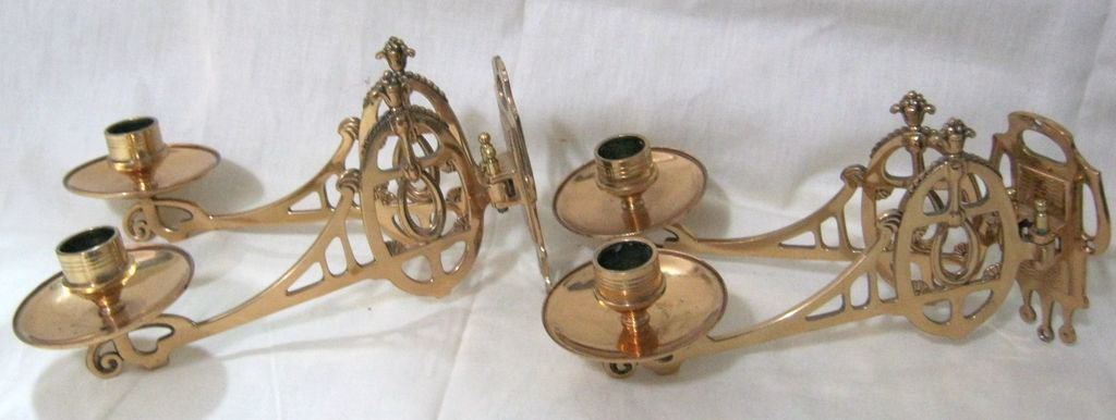 A Stunning Pair of Double Arm Brass Piano Candle Sconces Circa