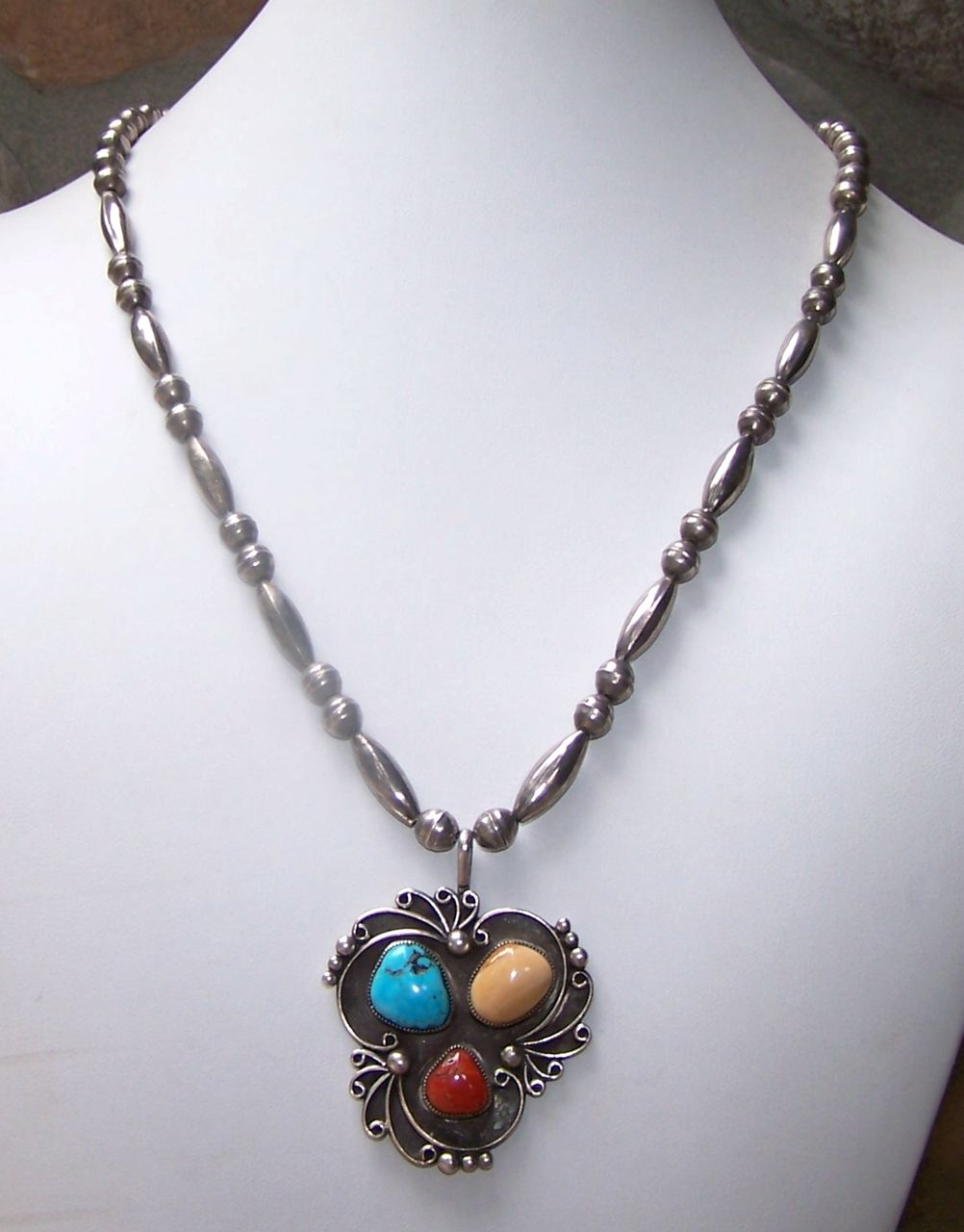 Signed Navajo Sterling Silver, Turquoise, Coral And Fossil Pendant Necklace