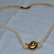 Vintage 1970's Gold Tone Shell Pendant On Cord Designed By Yves Saint Laurent