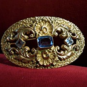 Brass and Light Sapphire Oval Art Nouveau  Brooch
