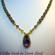 - Necklace with  Vitrail Swarovski Bezelled Crystal  Pendant in greens, copper, golds, - One o