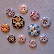 SOLD Collection of Eleven Different Calico Buttons