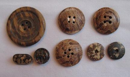 Group of Eight Composition Fleck Buttons, Large and Small