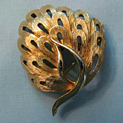 SALE Pretty Gold-tone Pin by J.J. � Stylized Peacock Design