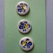 Three Ceramic Buttons with Blue and Yellow Flower