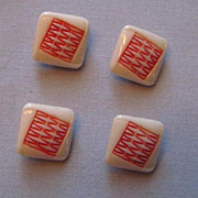Four White Milk Glass Buttons with Red Squiggles on Top