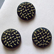 Trio of Buttons with Design of White Leaves on Black Background