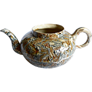 Small Agate Ware teapot, circa 1750, missing lid, some damage