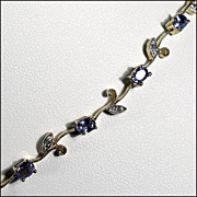 14K Gold, Tanzanite, and Diamond Necklace with Mille Grain Setting