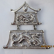 Monet Dragon/Pagoda Silvertone Brooch