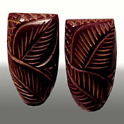 Carved BAKELITE Brown Dress Clips -- Art Deco