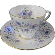 Avon footed Cup and Saucer: Blue Blossoms