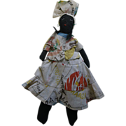 Black cloth girl doll with embroidered features