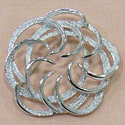 Tailored Swirl Silver Tone Pin by Sarah Coventry