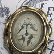 Antique gold plated ivory love bird locket pin