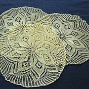 Set of Three Light Ecru Knitted Doilies