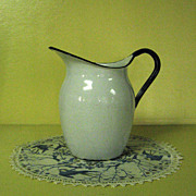White and Blue Enamel Ware Pitcher