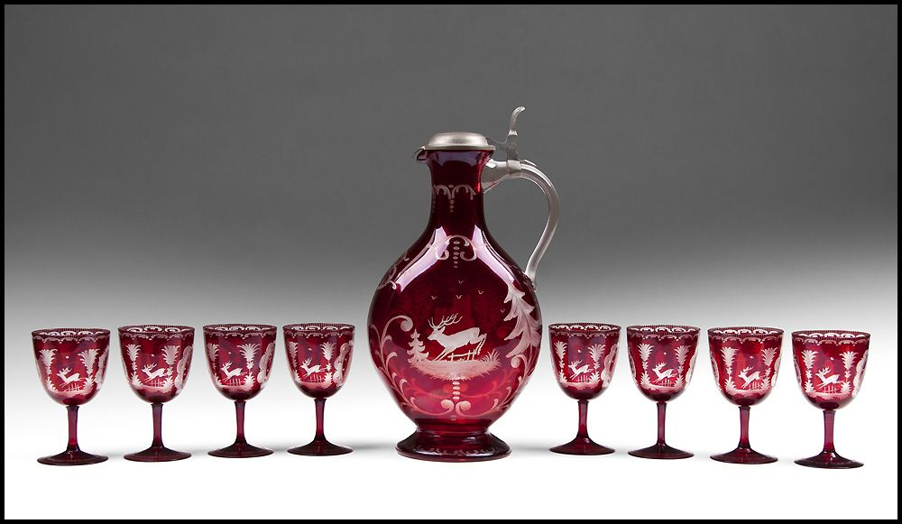 Nine Piece Set of Bohemia Ruby Stained And Engraved Wine Ewer With Goblets