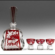 Four Piece Art Deco Czechoslovakian Ruby Stained Intaglio Cut Liqueur Set
