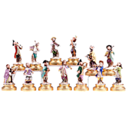 Thirteen Piece Volkstedt Porcelain Monkey Band on Gilded Stands