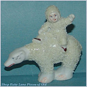 Miniature Bisque Snow Baby on a Polar Bear Figurine