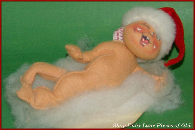 Vintage Annalee Santa Baby lying on a cloud c.1963