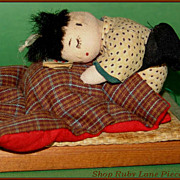 Little Japanese Baby Doll posed asleep in his bed