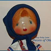 Russian Play Doll in traditional dress, waxy plastic c.1960