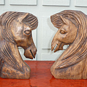 Pair of large carved horse head book-ends