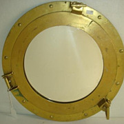 Brass porthole style mirror