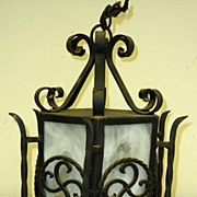Wrought iron lantern with slag glass