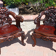 REDUCED Pair of Asian carved armchairs with monkeys