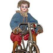 French Mechanical Bike Rider Antique Doll - Clockwork Mechanism - Bisque Head & Glass Eyes - 1