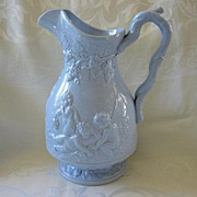 Light Blue Ironstone Pitcher with Relief Decoration