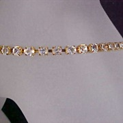 MONET - Diamante Prong Set Rhinestone and  Gold Plate Tennis Bracelet