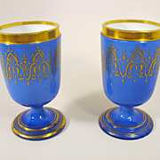 Pair of antique blue cased and gilded glass wine or water stem glasses