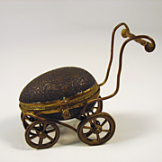 Vintage figural egg thimble holder in the form of a baby buggy pram